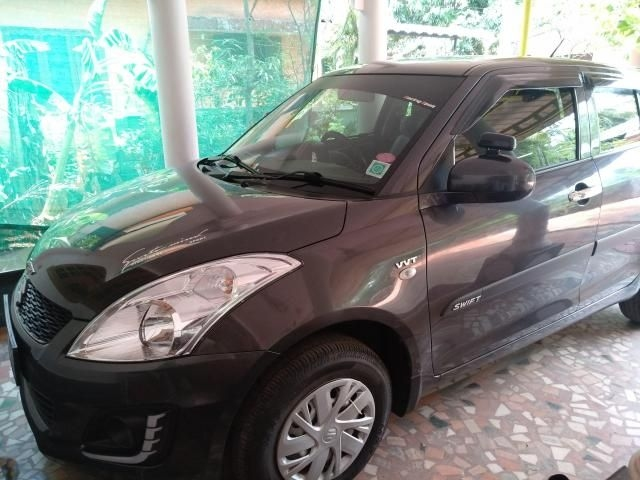 Maruti Suzuki Swift LXi Opt 2016